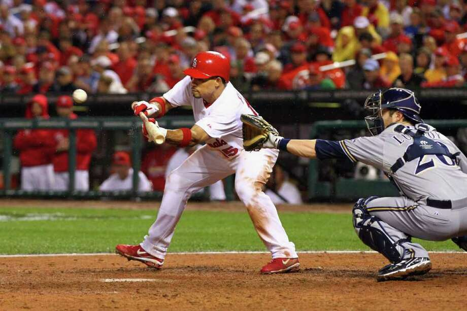 ST LOUIS, MO - OCTOBER 12:  Rafael Furcal #15 of the St. Louis Cardinals hits a sacrifice bunt to move the runner over in the bottom of the sixth inning against the Milwaukee Brewers during Game Three of the National League Championship Series at Busch Stadium on October 12, 2011 in St Louis, Missouri. Photo: Dilip Vishwanat, Getty / 2011 Getty Images