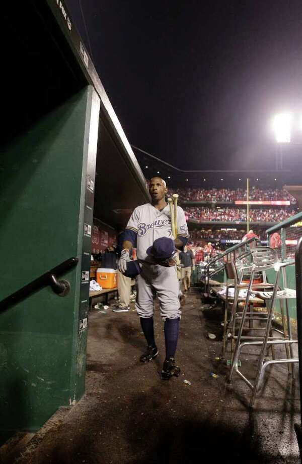 Milwaukee Brewers' Nyjer Morgan walks out of the dugout after Game 3 of baseball's National League championship series against the St. Louis Cardinals Wednesday, Oct. 12, 2011, in St. Louis. The Cardinals won 4-3 to take a 2-1 lead in the series. (AP Photo/Matt Slocum) Photo: Matt Slocum, Associated Press / AP