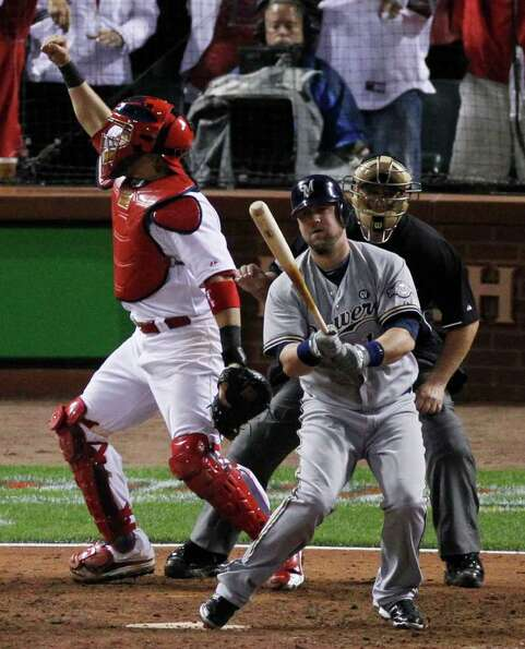 St. Louis Cardinals catcher Yadier Molina reacts after Milwaukee Brewers' Casey McGehee strikes out