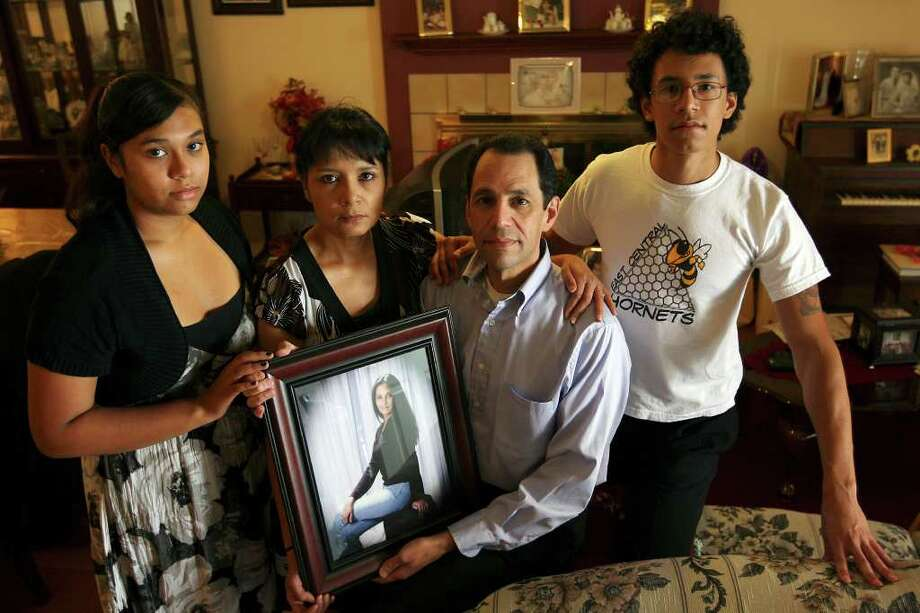 The Villegas family  mourns the death of East Central High School math teacher Melinda Villegas, 23, Wednesday, Oct. 12, 2011. The teacher collapsed in the teacher's workroom Monday morning. From left, are sister Julie, 16, parents Debra and Robert, both 50, and brother Michael Villegas, 19. The University of Texas at San Antonio graduate was in her second year of teacher and her first at the high school. Photo: Jerry Lara/glara@express-news.net / SAN ANTONIO EXPRESS-NEWS