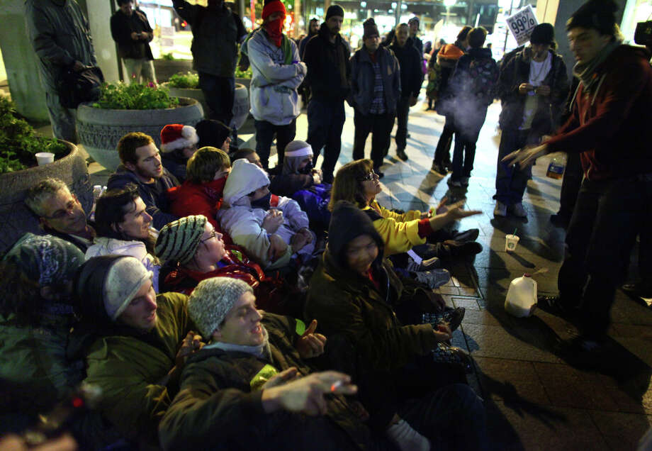 Occupy Seattle demonstrator prepare to be arrested at Westlake Park on Wednesday, Oct. 12, 2011. About 150 refused the order and two were arrested. Photo: JOSHUA TRUJILLO / SEATTLEPI.COM