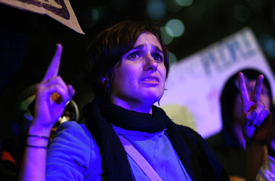 An Occupy Seattle demonstrator reacts to approaching police at Westlake Park. Photo: JOSHUA TRUJILLO / SEATTLEPI.COM
