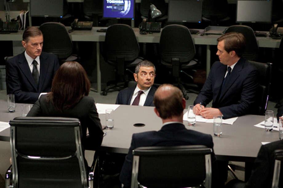 "Rowan Atkinson (center) as Johnny English in ""Johnny English Reborn."" Photo: Giles Keyte / 2011 Universal Studios"