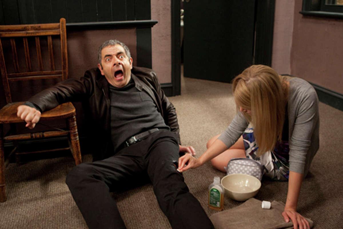Rowan Atkinson as Johnny English in