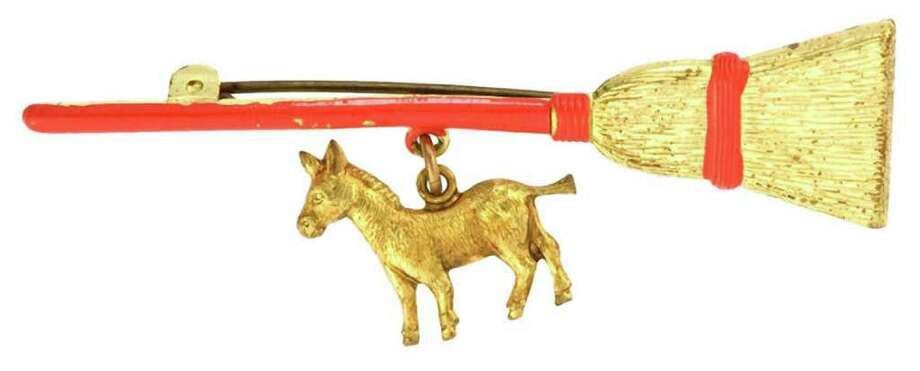 Political collectors know that this broom-and-donkey pin was made for Franklin Rooseveltís 1932 presidential campaign. It sold, over estimate, for $113 at a Hakeís Americana and Collectibles auction in York, Pa. Photo: Contributed Photo