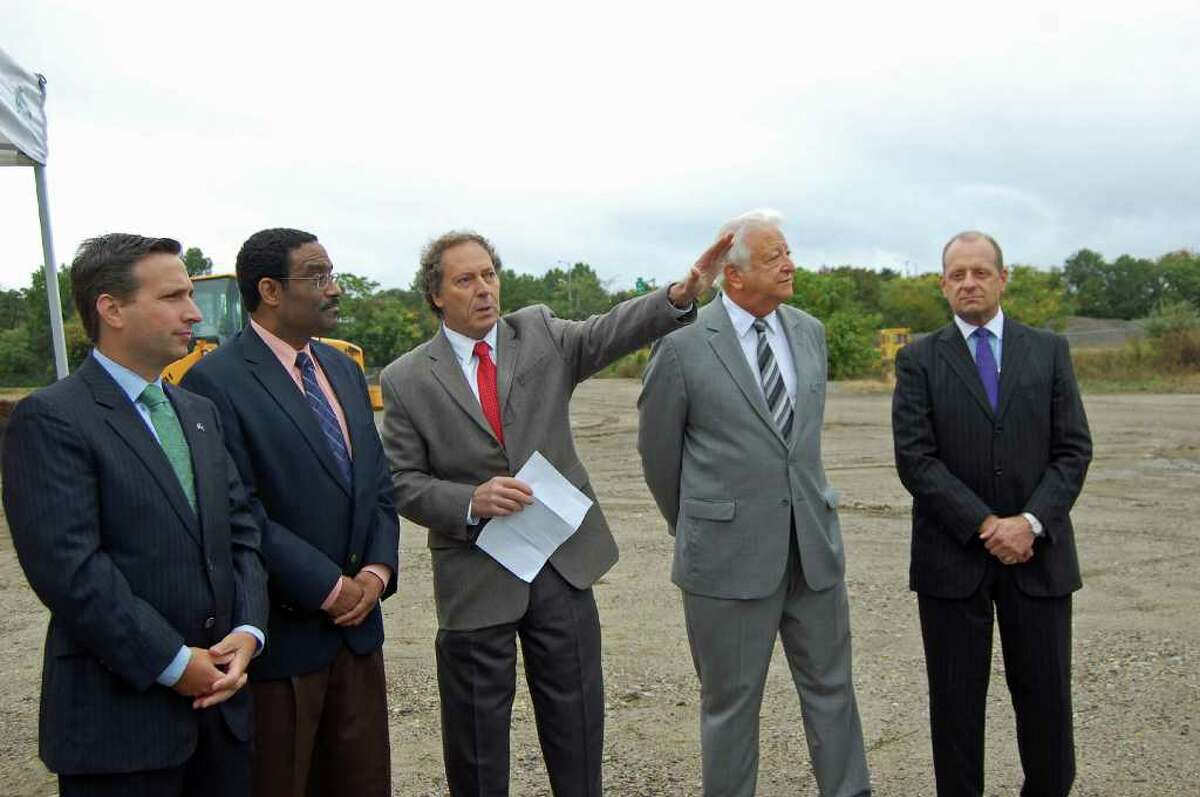 Clayton Fowler, chairman and CEO of Spinnaker Real Estate Partners, points to the 2.7-acre parcel of land that will be home to the first residential building in a complex of buildings that will comprise District 95/7 at a groundbreaking ceremony Thursday morning. He is flanked by, from left: State Sen. Bob Duff; state Rep. Bruce Morris; Norwalk Mayor Richard Moccia and Emil Albanese, chairman of the Norwalk Redevelopment Agency. The Spinnaker-led development project will eventually have a combination of retail, office, residential and hotel space.