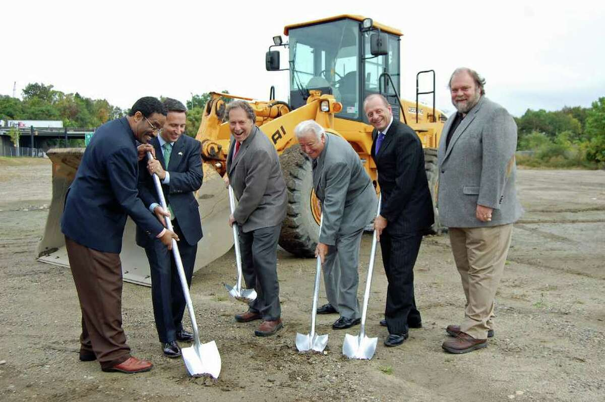 Clayton Fowler, chairman and CEO of Spinnaker Real Estate Partners, raises his shovel at a groundbreaking ceremony Thursday morning for District 95/7. He is flanked by, from left: state Rep. Bruce Morris; state Sen. Bob Duf; Norwalk Mayor Richard Moccia and Emil Albanese, chairman of the Norwalk Redevelopment Agency, and Common Council Member Douglas Hempstead. The Spinnaker-led development project will eventually have a combination of retail, office, residential and hotel space.
