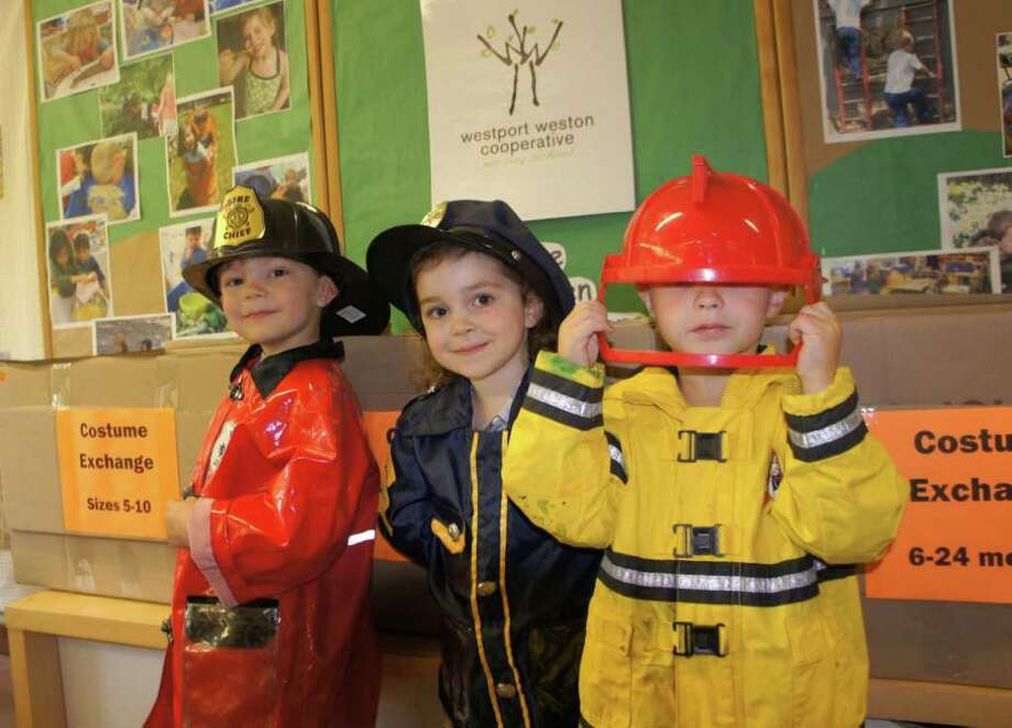 Four-year old students Tanner Sticco, Sarah Manners and John Jansen dress up while shopping for their Halloween costumes from the swap bins at the Westport Weston Cooperative Nursery School. Photo: Contributed Photo