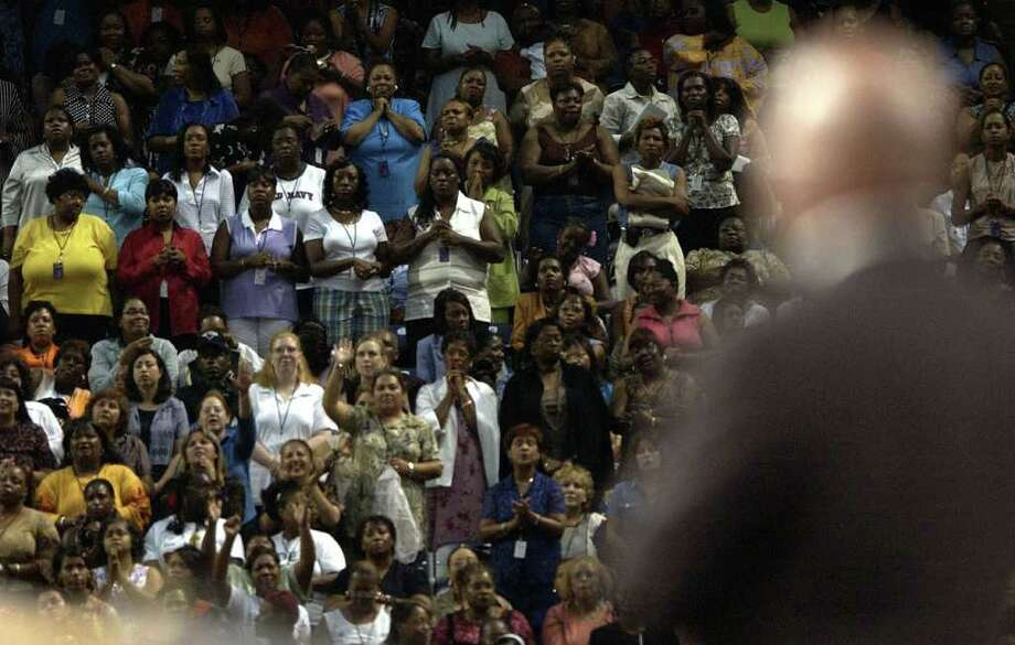 "(7/17/03) Bishop T.D. Jakes, one of America's best known preachers, sings ""Amazing Grace"" to a crowd of women at Reliant Stadium, Thursday evening during the ""Women Thou Art Loosed"" conference.  (Karen Warren/Houston Chronicle) Photo: Karen Warren / Houston Chronicle"