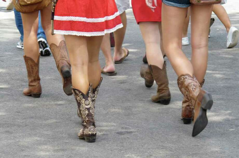 Girls in cowboy boots, Texas State Fair, Dallas. Photo: Rebecca A. Roper