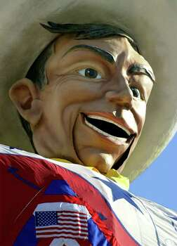 The State Fair of Texas' 52-foot mechanical cowboy, Big Tex, sports an American flag and red, white and blue ribbons on his chest as he turns his head and tells people about events during opening day, Friday, Sept. 28, 2001, in Dallas. This year's fair runs for 24 days.  (AP Photo/Bill Janscha)  HOUCHRON CAPTION  (08/25/2002):  State Fair icon Big Tex has a music festival named in his honor. Photo: BILL JANSCHA / AP