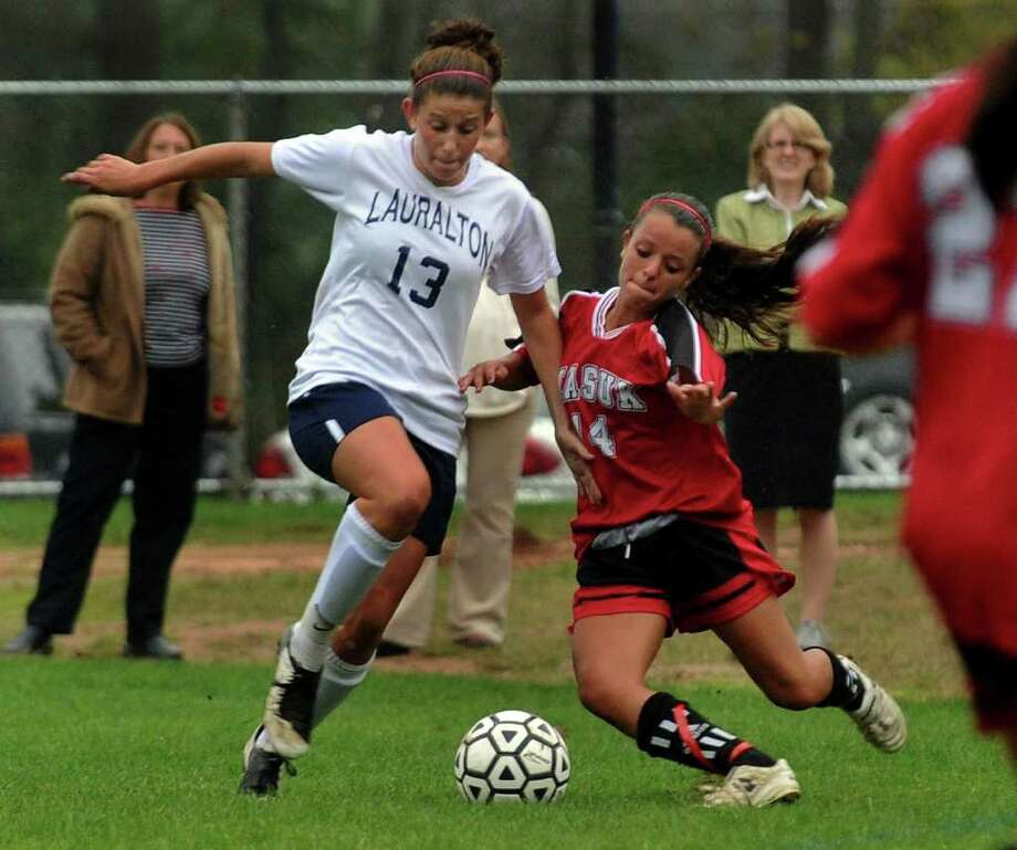 Lauralton Hall's #13 Alyssa Fratarcangeli, left, and Masuk's #14 Laura Mangone scramble for control of the ball, during girls soccer action at Lauralton Hall in Milford, Conn. on Thursday October 13, 2011. Photo: Christian Abraham / Connecticut Post