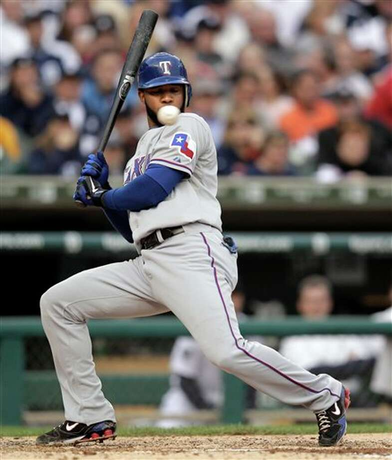 Texas Rangers' Elvis Andrus avoids a pitch by Detroit Tigers' Justin Verlander during the fifth inning in Game 5 of baseball's American League championship series Thursday, Oct. 13, 2011, in Detroit. (AP Photo/Charlie Riedel) Photo: Associated Press
