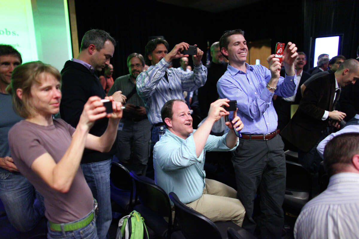 Microsoft employees photograph presidential candidate Mitt Romney after he delivered a speech on the Microsoft campus in Redmond.