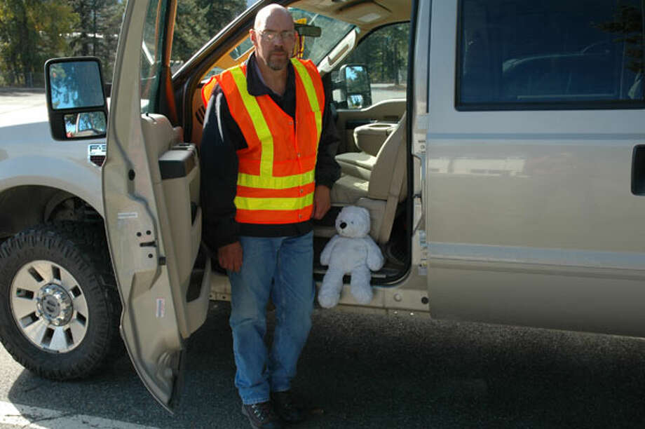 "WSDOT assistant maintenance Superintendent Harry Nelson with ""Daddy Bear."" Photo: Courtesy Of WSDOT"