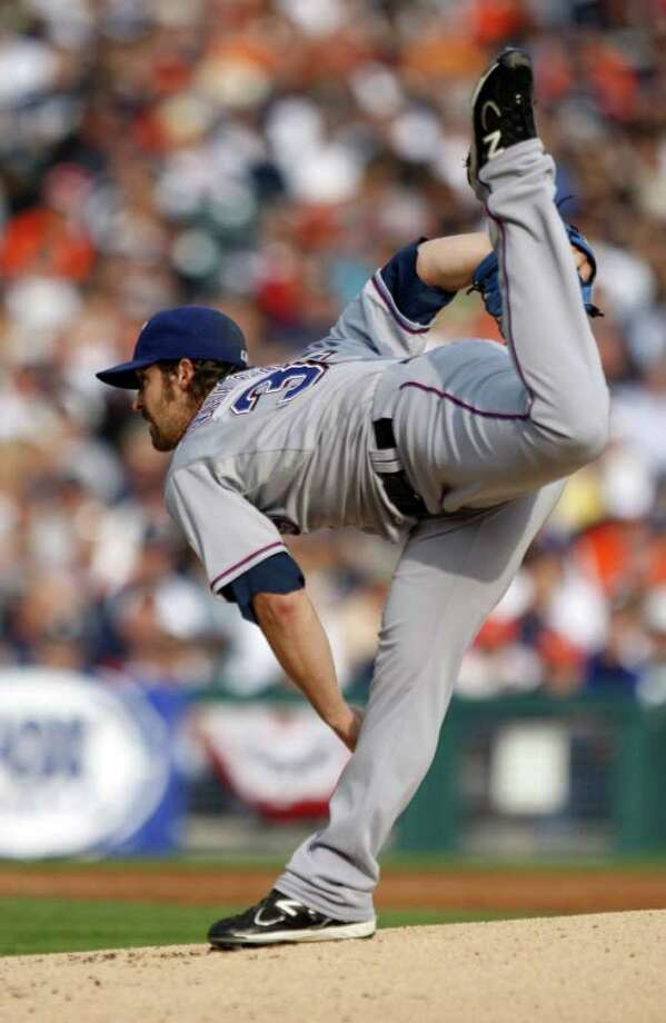 Rangers pitcher C.J. Wilson works during first-inning action. Photo: Kirthmon F. Dozier, McClatchy-Tribune News Service / Detroit Free Press