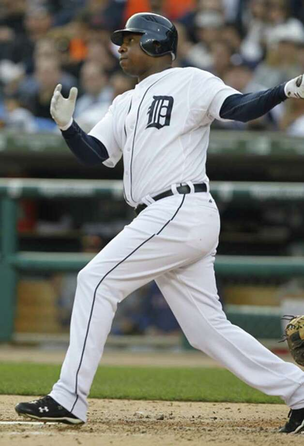 Tigers' Delmon Young hits a solo home run during the fourth inning. (Julian H. Gonzalez/Detroit Free Press/MCT) Photo: Julian H. Gonzalez, McClatchy-Tribune News Service / Detroit Free Press