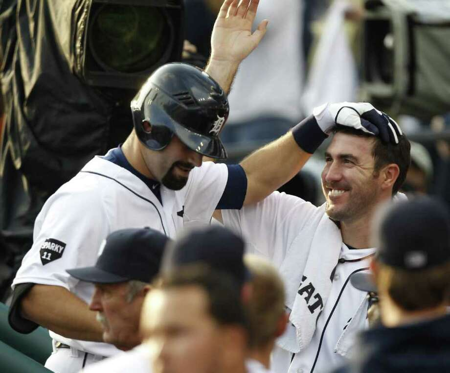 Tigers' Alex Avila gets congratulated by Justin Verlander after his solo home run. Photo: Julian H. Gonzalez, McClatchy-Tribune News Service / Detroit Free Press