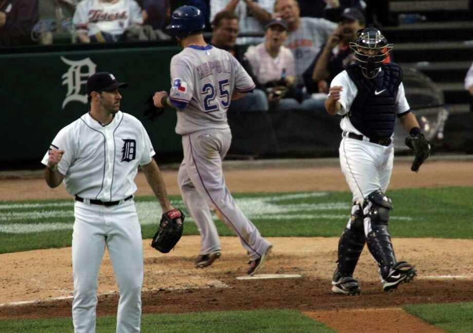 Detroit Tigers pitcher Justin Verlander, left, and Alex Avila celebrate a double play sixth inning. Photo: Andre J. Jackson, McClatchy-Tribune News Service / Detroit Free Press