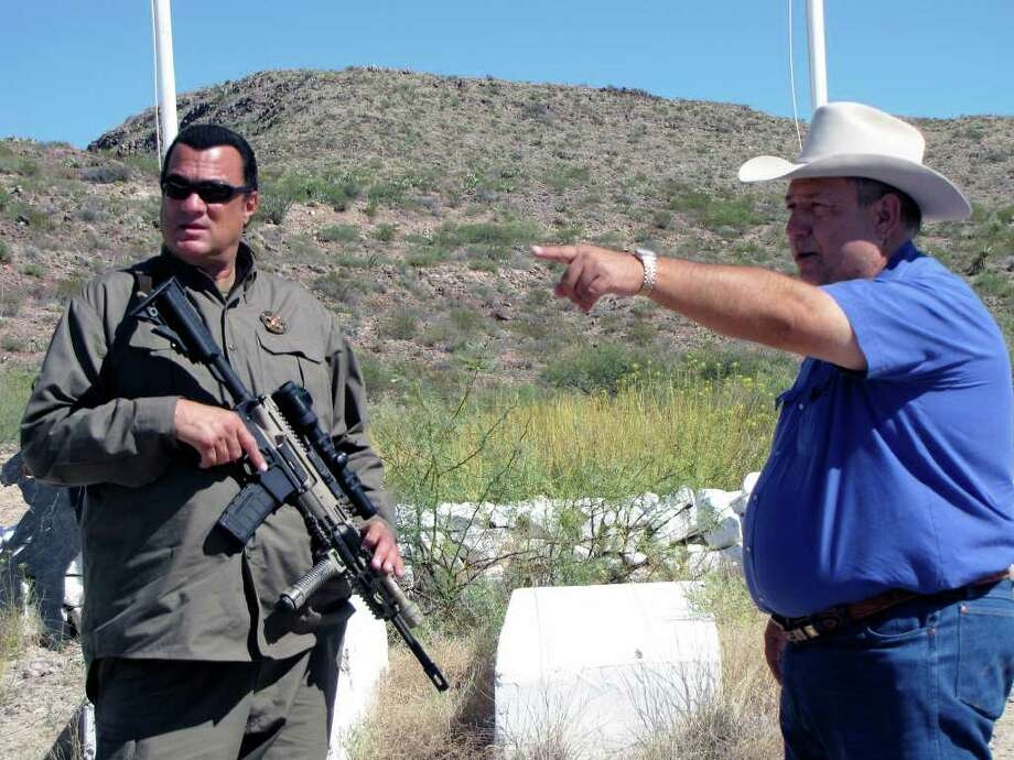 "Sheriff Arvin West gestures while talking to Steven Seagal, who is due to start his job as ""deputy chief to the chief deputy"" in the Hudspeth County Sheriff's Office early next year. Photo: Courtesy Photo/Hudspeth County Sheriff's Department"