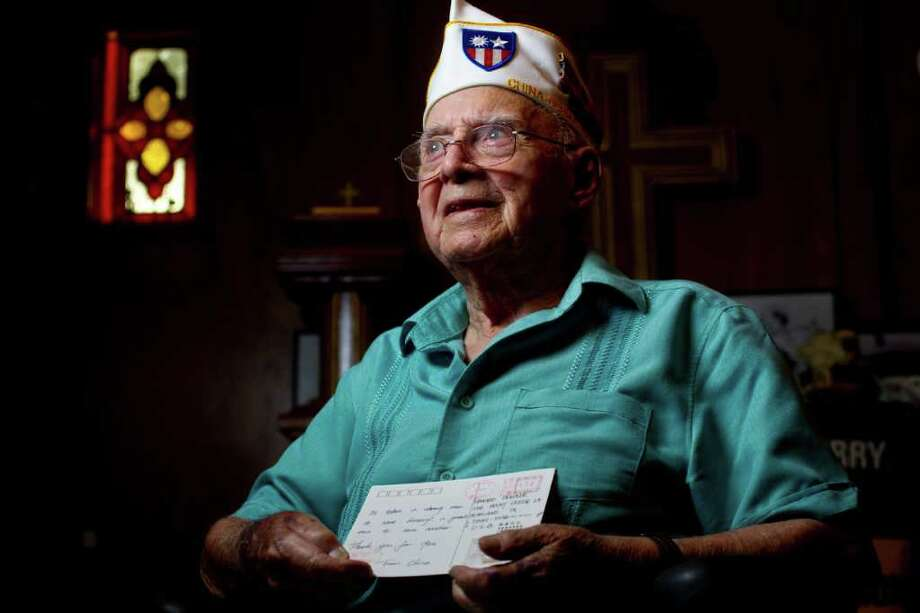 Ed Denzler was baffled by the postcard from China he received in Pearland. Even when an engineer at NASA translated it, the World War II veteran was stumped. Photo: Karen Warren / © 2011 Houston Chronicle