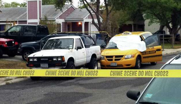 A white sheet covers the windshield of a Yellow Cab van, where a man was found fatally shot in the driver's seat early Monday. San Antonio police said little about the Northeast Side killing. Photo: Eva Ruth Moravec/emoravec@express-news.net / SAN ANTONIO EXPRESS-NEWS