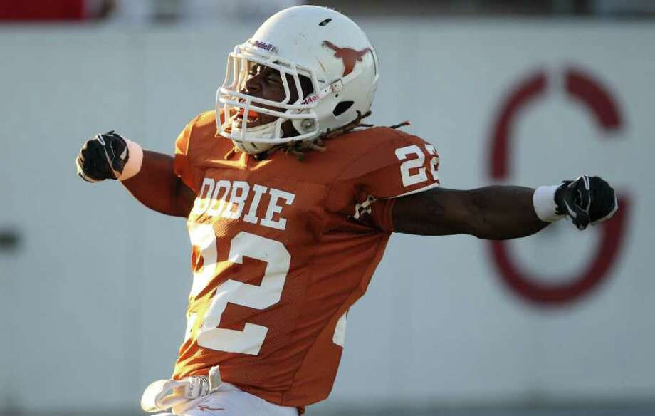 Andrew Robinson, of Dobie High School, celebrates after scoring a touchdown during the first quarter of a District 22 5-A football game against \Memorial High School, Thursday, Oct. 13, 2011, at Veterans Memorial Stadium in Pasadena. Photo: Nick De La Torre, Houston Chronicle / © 2011  Houston Chronicle