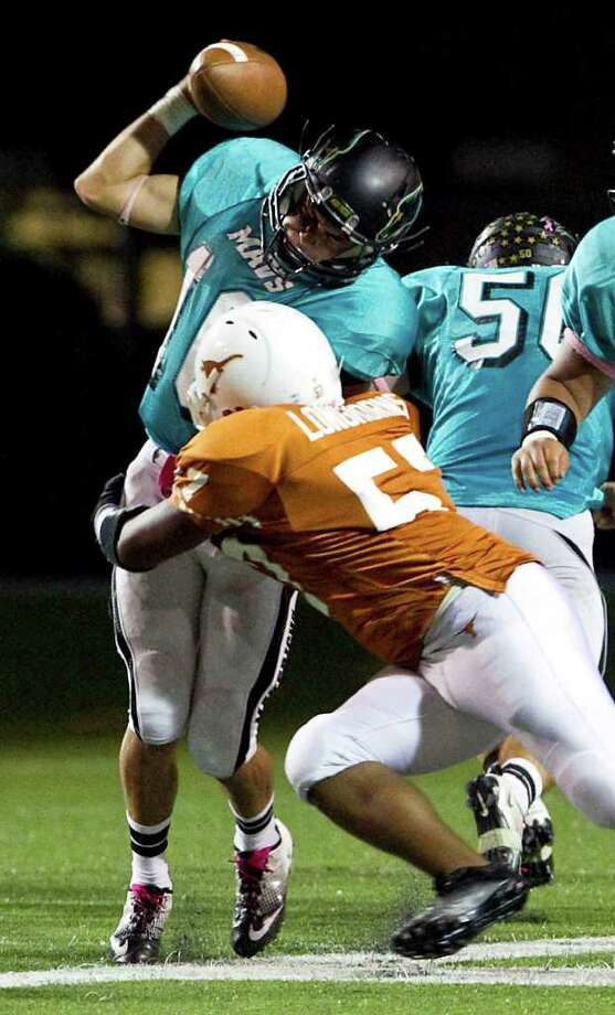 Pasadena Memorial High School quarterback Greg Gallardo gets sacked by Dobie High School's Fabaian Davalos in the third quarter of a District 22 5-A football game Thursday, Oct. 13, 2011, at Veterans Memorial Stadium in Pasadena. Photo: Nick De La Torre, Houston Chronicle / © 2011  Houston Chronicle