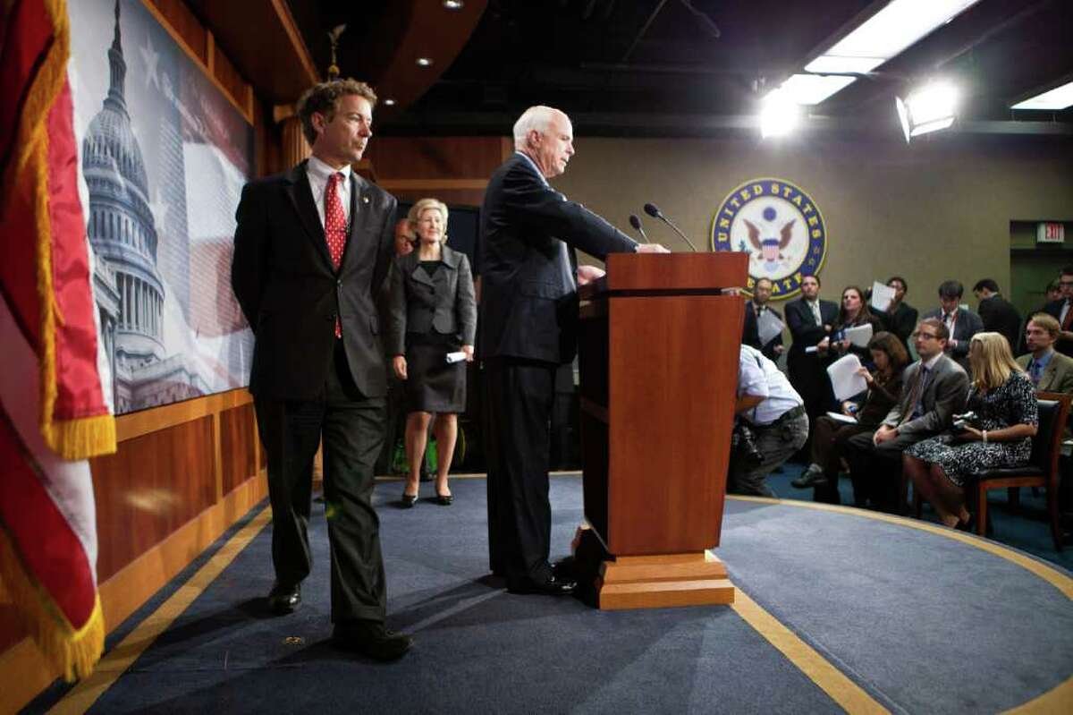 WASHINGTON - OCTOBER 13: (L-R) U.S. Sen. Rand Paul (R-KY), U.S. Sen. Kay Bailey Hutchison (R-TX), and U.S. Sen. John McCain (R-AZ) arrive for a news conference on Capitol Hill to introduce a Republican jobs proposal to compete with that put forward by President Obama on October 13, 2011 in Washington, DC. The legislation targets the tax code, spending, and regulation in an attempt to grow the private sector. (Photo by Brendan Hoffman/Getty Images)