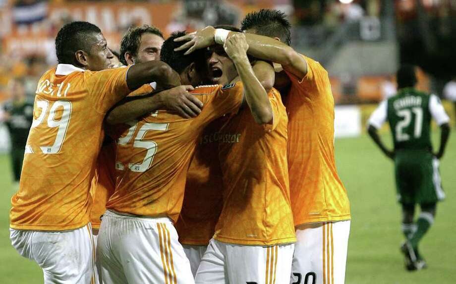 CODY DUTY: CHRONICLE HOPING FOR AN ENCORE: Two first-half goals, including one from Brian Ching (25), were all the Dynamo needed to beat the Portland Timbers on Aug. 14 at Robertson Stadium. Photo: Cody Duty / © 2011 Houston Chronicle