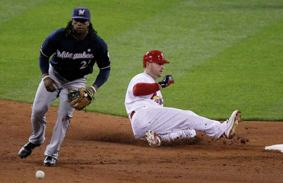 Milwaukee Brewers' Rickie Weeks takes the throw as St. Louis Cardinals' Matt Holliday slides safely