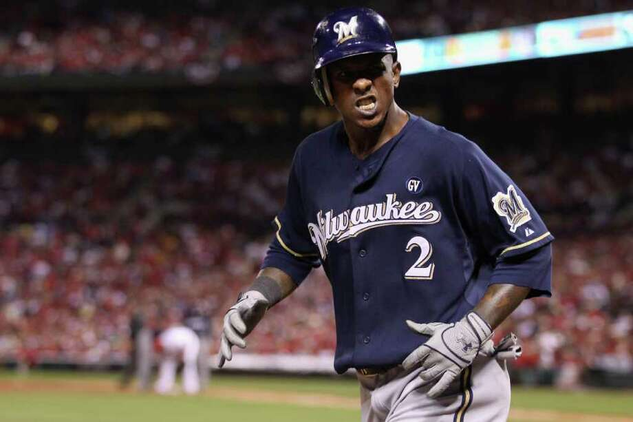 Nyjer Morgan of the Milwaukee Brewers reacts after he scored on a RBI single by Ryan Braun. Photo: Christian Petersen / 2011 Getty Images