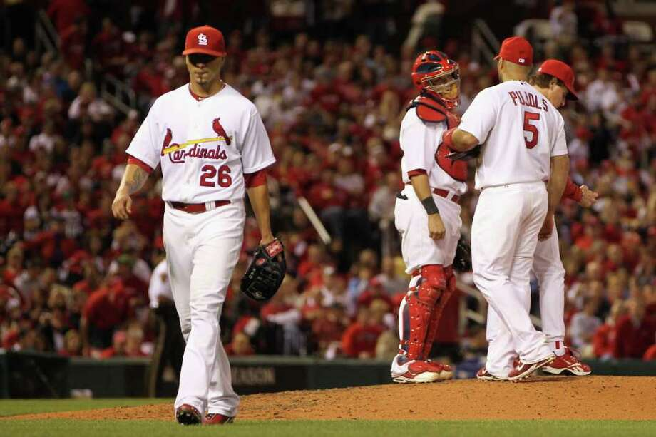 Kyle Lohse of the St. Louis Cardinals walks back to the dugout after he was taken out of the game in the top of the fifth inning. Photo: Jamie Squire / 2011 Getty Images