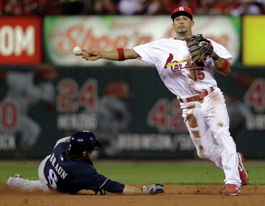 St. Louis Cardinals' Rafael Furcal throws past a sliding Milwaukee Brewers' Ryan Braun to turn a double play on a ball hit by Prince Fielder. Photo: David J. Phillip / AP