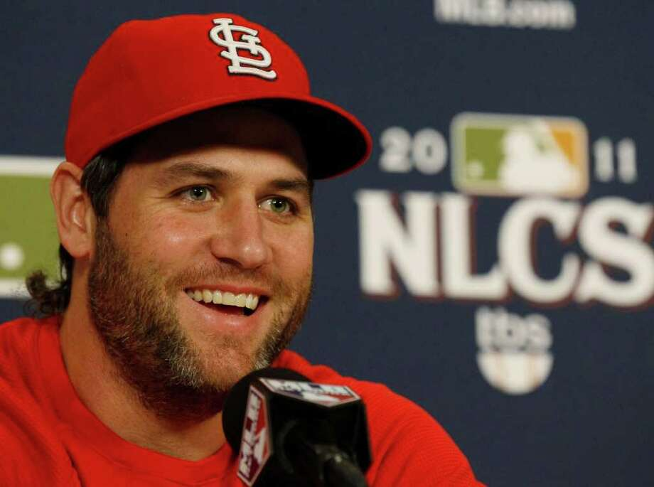 St. Louis Cardinals' Lance Berkman smiles as he answers questions during a news conference before Game 4 of baseball's National League championship series against the Milwaukee Brewers Thursday, Oct. 13, 2011, in St. Louis. Berkman and Jacoby Ellsbury of the Boston Red Sox were named baseball's comeback players of the year. (AP Photo/Charles Rex Arbogast) Photo: Charles Rex Arbogast / AP