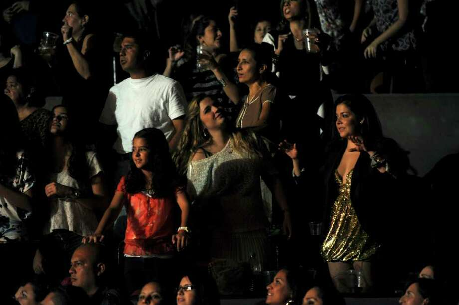 Fans enjoy the show as singer Enrique Iglesias performs at the AT&T Center on Thursday, Oct. 13, 2011. Photo: Billy Calzada/gcalzada@express-news.net / gcalzada@express-news.net