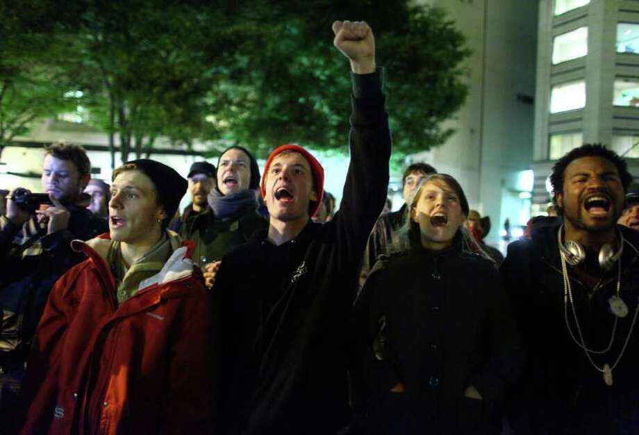 Occupy Seattle protesters chant in Westlake Park on Thursday, October 13, 2011. Ten of the protesters were arrested for refusing to move from a makeshift structure. Photo: JOSHUA TRUJILLO / SEATTLEPI.COM