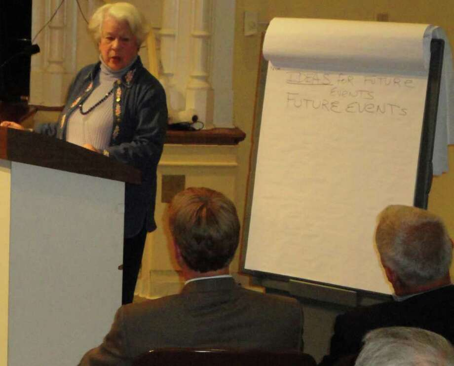 Sue Harris of Weston directed outrage over lengthy  power outages after Tropical Storm Irene toward two representatives from Connecticut Light & Power at a Thursday night public forum in Westport Town Hall. Photo: Meg Barone / Westport News freelance