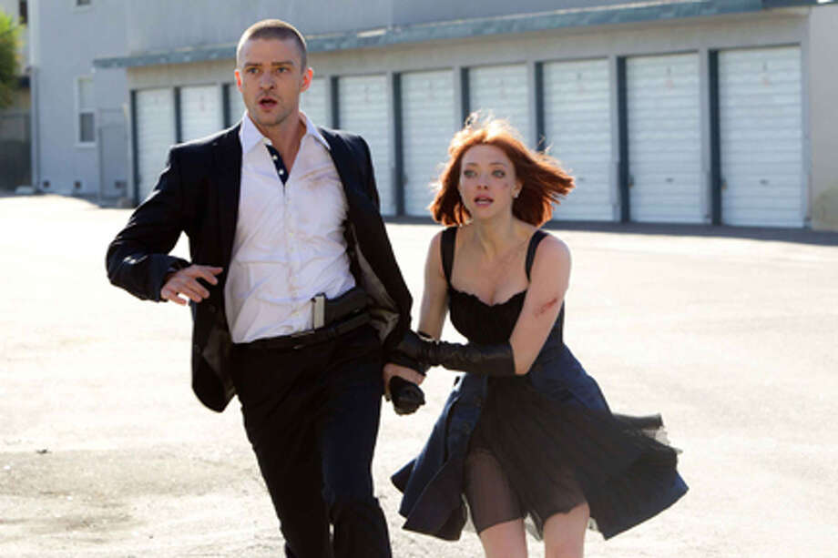 "Justin Timberlake as Will Salas and Amanda Seyfried as Sylvia Weis in ""In Time."" Photo: Photo Credit: Stephen Vaughan"