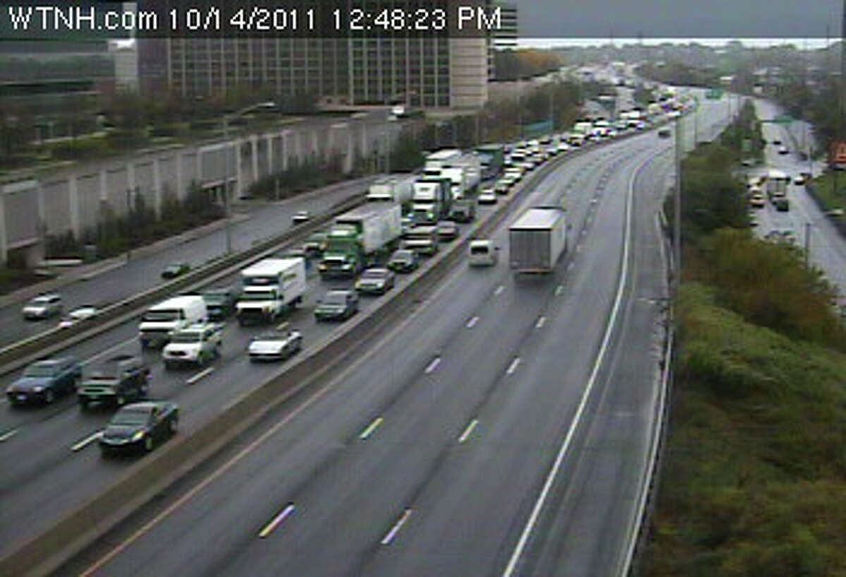 Traffic is snarled in both directions on Interstate 95 in Stamford and Greenwich after a car fell off a carrier truck and rolled over in the northbound roadway near exit 7, state police said. Northbound traffic is backed up several miles toward the state line, and southbound traffic is snarled several miles back toward the Darien town line.