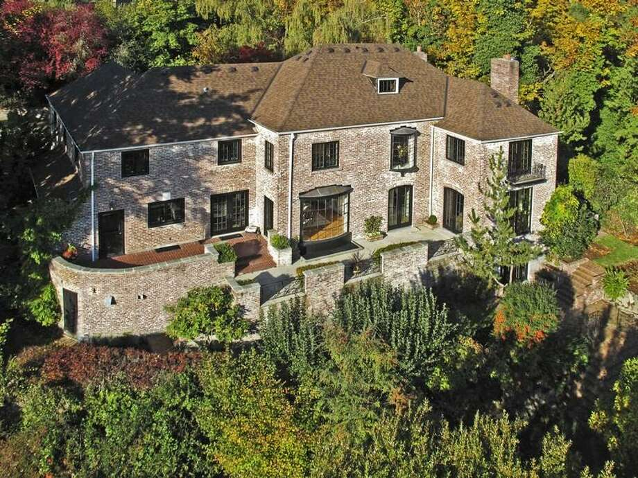 Here's a classic estate in Seattle's Mount Baker neighborhood, at 1908 34th Ave. S. The 9,500-square-foot brick house has seven bedrooms and 7.5 bathrooms, wood floors and paneling, wrought-iron railings, leaded-glass and a 1.07-acre lot with development potential. It's listed for $2.888 million. Photo: Sotheby's International Realty