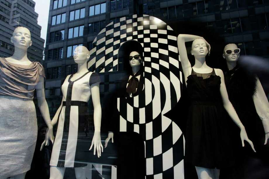 Mannequins are fashionably dressed in a Bloomingdale's store window, Thursday, Oct. 13, 2011 in New York. U.S. consumers stepped up their spending on retail goods in September, a hopeful sign for the sluggish economy. (AP Photo/Mark Lennihan) Photo: Mark Lennihan / AP