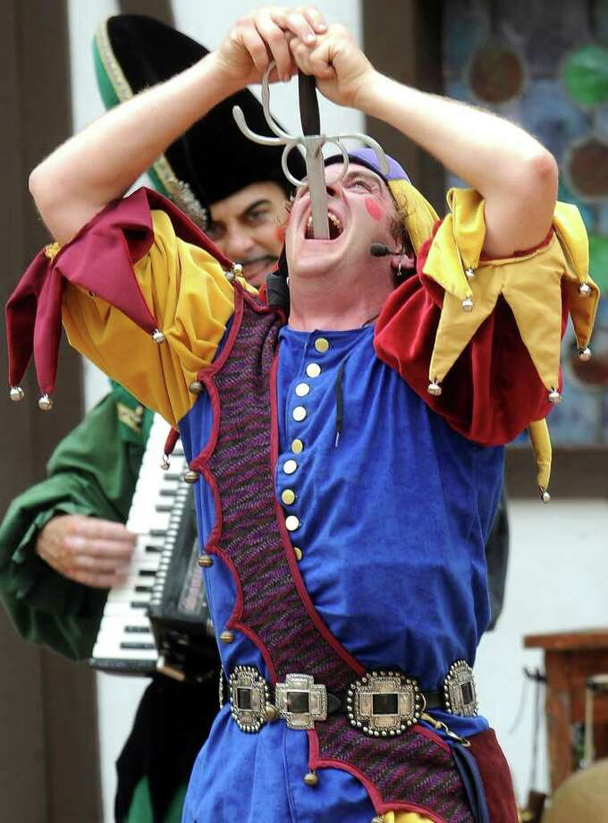 A performer with Clan Tynker Family circus swallows a sword during the Texas Renaissance Festival, Saturday, October 8, 2011. Tammy McKinley/The Enterprise Photo: TAMMY MCKINLEY