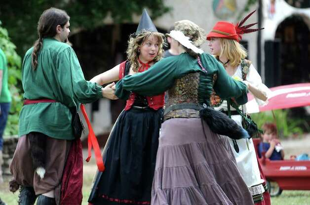 Dancers perform a traditional folk dance during the Texas Renaissance Festival, Saturday, October 8, 2011. Tammy McKinley/The Enterprise Photo: TAMMY MCKINLEY