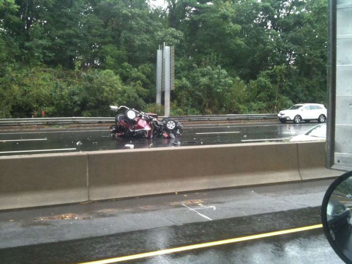 A car was heavily damaged after it fell from the back of a car carrier on Interstate 95 near exit 7 Friday, Oct. 14, 2011. WTNH Report It photo.