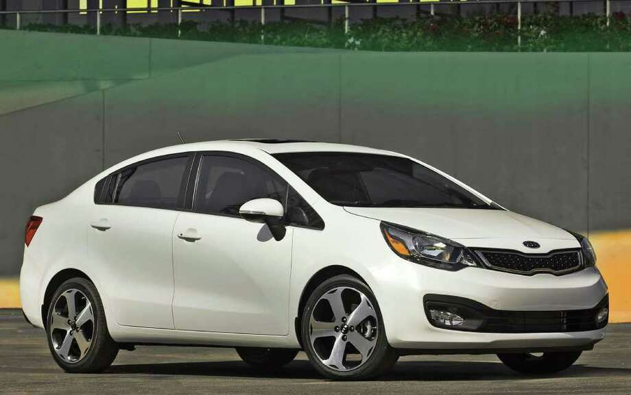 Kia has redesigned its Rio subcompact models for 2012, including the sedan, shown here, and the five-door hatchback. COURTESY OF KIA MOTORS AMERICA Photo: Kia Motors America, COURTESY OF KIA MOTORS AMERICA