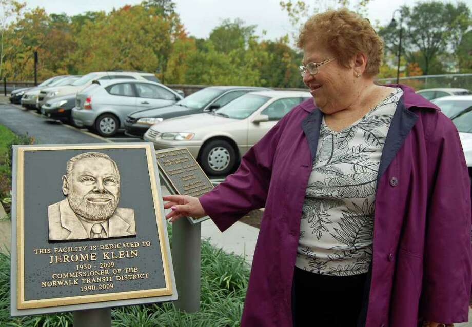 Arlene Klein, wife of the late Jerry Klein, longtime Norwalk Transit District commissioner, admires a plaque honoring her husband at the official opening of the city's new WHEELS Hub, which was also dedicated to Jerry, Friday morning. Photo: Nicole Rivard/Staff Photographer