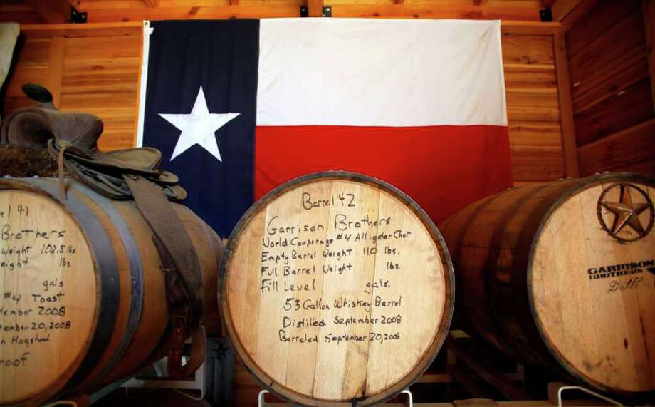 Barrels of Garrison Brothers bourbon are stored at the Hye distillery. Bourbon made this fall won't be bottled for sale until late 2013. Photo: WILLIAM LUTHER, SAN ANTONIO EXPRESS-NEWS / 2011 SAN ANTONIO EXPRESS-NEWS
