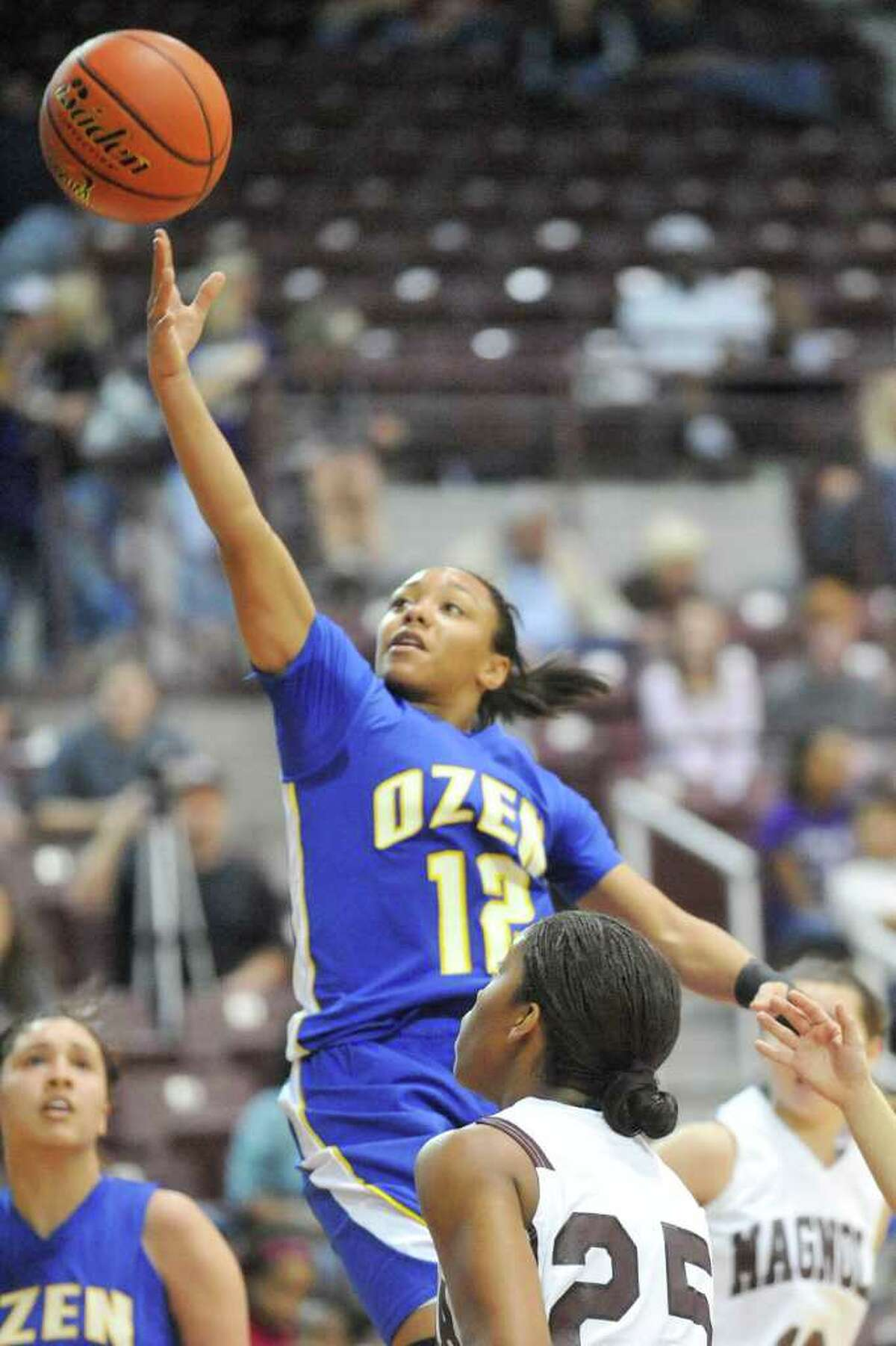 Ozen guard Asia Booker drives down the middle for a layup against Magnolia in their Region 3 Area Playoff game at the Aldine Campbell Center on Friday, February 18, 2011. Valentino Mauricio/The Enterprise