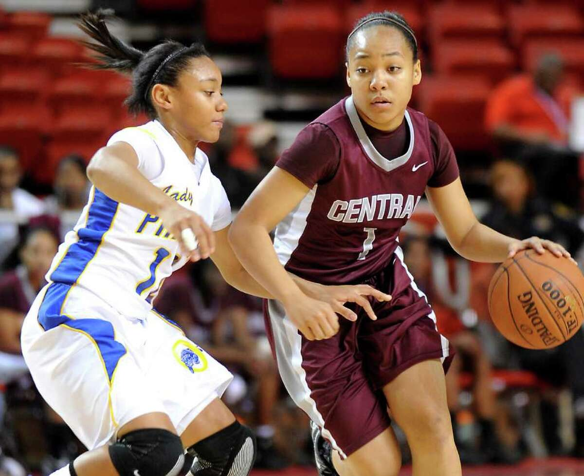 Central's Malena Washington drives the ball as Ozen's Asia Booker guards in the Montagne Center at Lamar University in Beaumon last season. Ozen and Central are in the TABC preseason rankings. Tammy McKinley/The Enterprise